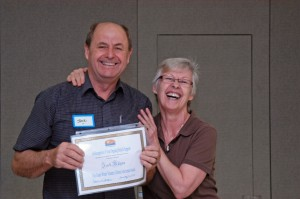 Maureen Jung presents her husband Jack Ryne with an award.