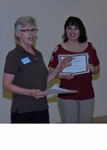 Maureen presented Dawn Burr with an award.