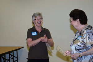 Maureen presented Nancy Payne with an award.
