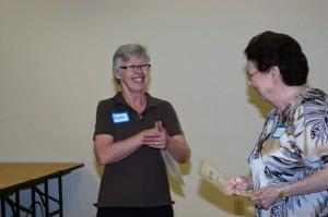 Maureen presented Nancy Payne with an award.